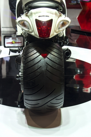 Dubai, UAE - NOVEMBER-14-2011: Suzuki motorcycle tyre on display at the Dubai Motor Show, UAE.