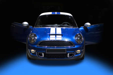 Blue cute sport car isolated on black background photo