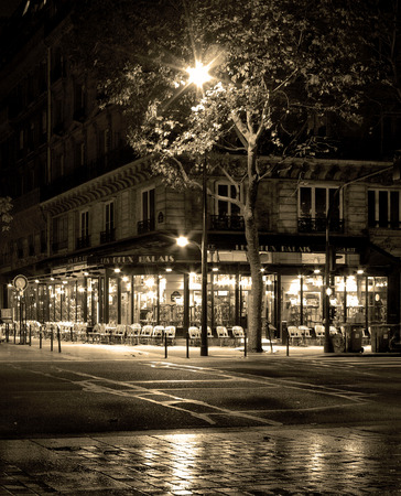 coffee shop in paris at rainy night