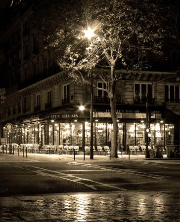 coffee shop in paris at rainy night