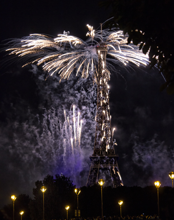 PARIS - JULY 14: Famous fireworks near Eiffel Tower during celebrations of french national holiday, Bastille Day, in Paris, France, on July 14th 2014. Editorial