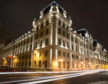 parisian scene: paris palais of justice at night