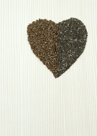 linseed: chia, flax seeds in shape of heart, organic food