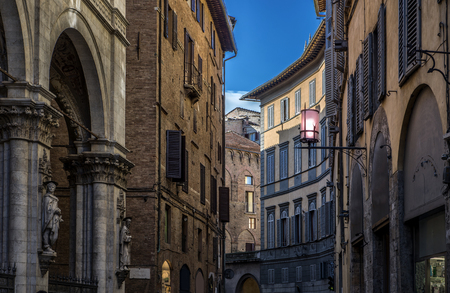 street with tipical italian arhitecture in siena itali, day time