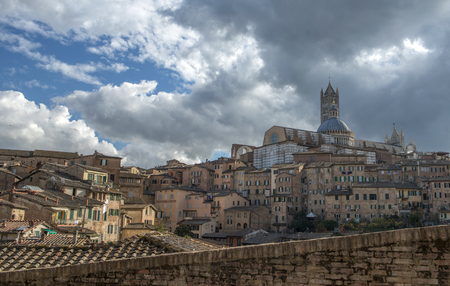 panoramic view of Santa Maria catedral,Siena, Tuscany, Italy with dramatic cloudy sky, day time