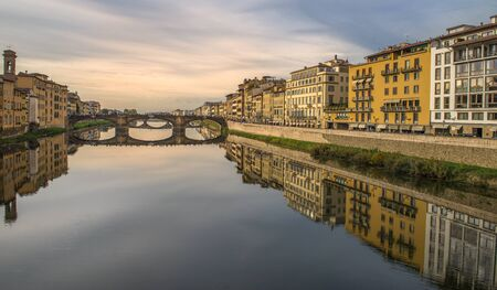water reflections of buildings in river Arno, Florence, Italy