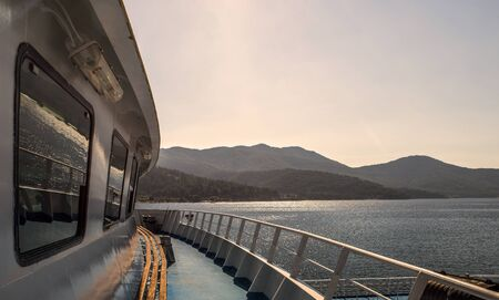 Ferry boat deck, aproaching land from the sea