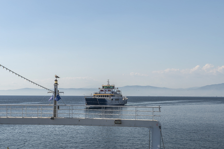 Ferry boat in the sea with passengers on board, back view  Stock Photo