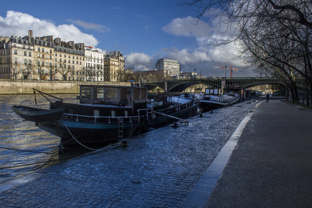 Boats in sena river on pier, Paris city
