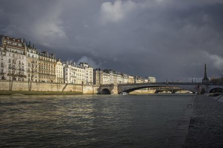 Bridge on sena river in Paris after storm