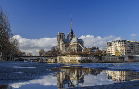 Paris, Notre Dame cathedral areal view with water reflection