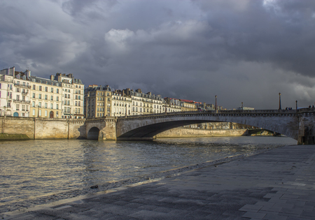 Sena river in Paris with storm aproaching