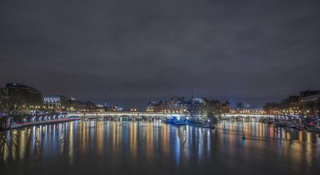 Sena river in Paris at night, light reflections