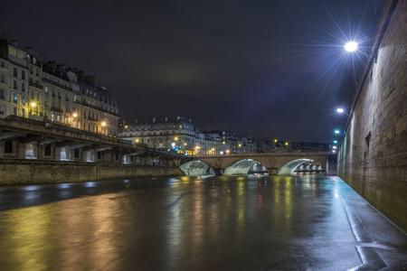 Sena river reflections in Paris at night Stock Photo
