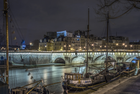 Boats in Paris on pier, hight time