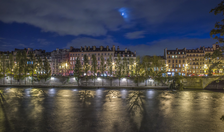 Paris at night, river reflectons with moon sunlight Stock Photo
