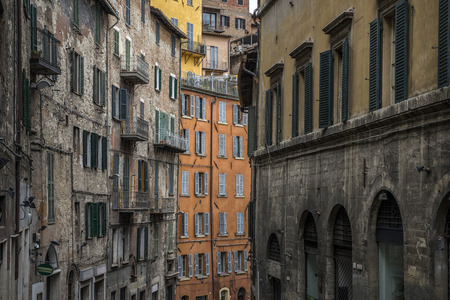old windows and balconies in Italy, narow street