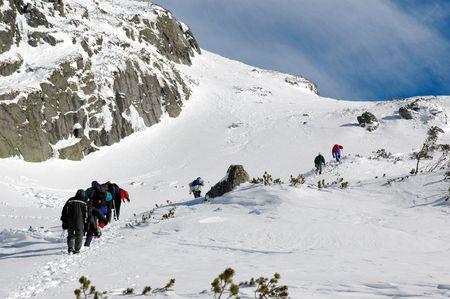A team climbing a high mountain
