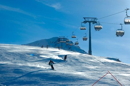 skiers on chair lift  Stock Photo