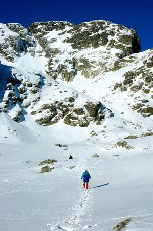 Man hiking in the high mountain