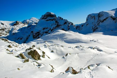 In the high, winter mountain                   Stock Photo