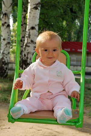 baby at swing Stock Photo