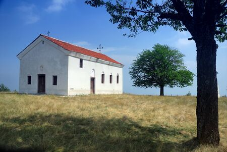 Small old church at the mountain Stock Photo