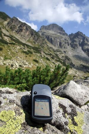 Navigate with GPS in the mountain photo