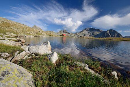 Tevno Lake in Pirin Mountain, Bulgaria, beautiful sky and hut