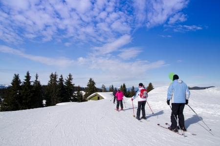 Skiing, winter fun - happy family ski team Stock Photo