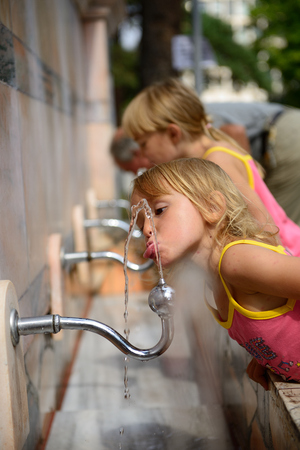 Girl at drinking fountain