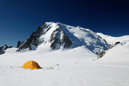 yellow touristic tent before ice wall