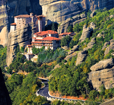 Roussanou monastery at Meteora, Greece, with road and rocks Stock Photo