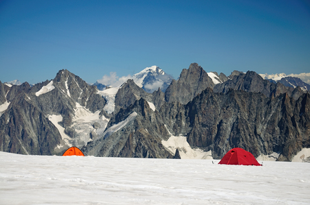 Touristic tents before mountains in Mont Blanc massive Stock Photo