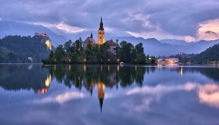 Church of the Assumption in Lake Bled with the castle in the background, Slovenia Editorial