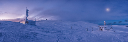 Winter sunset snow field on top of mountain under colorful sky.Vitosha, Bulgaria