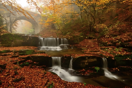Autum colors, waterfalls and bridge in Rodopi mountain Stock Photo