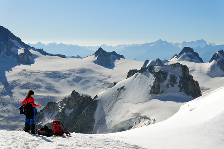 Climbers in a high winter mountain, Mont Blanc massive, France
