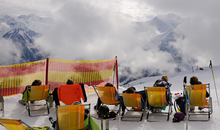 Ski vacation -resting skier in ski resort Stock Photo