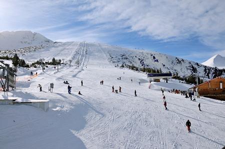 Ski zone Bansko, Bulgaria in sunny day Stock Photo