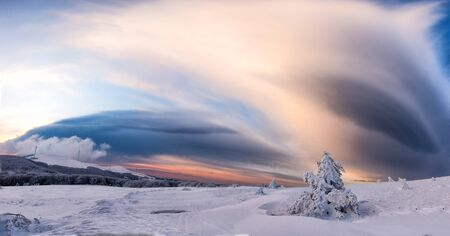 Beautiful winter landscape with frozen lake, crack and sunset sky. Composition of nature.