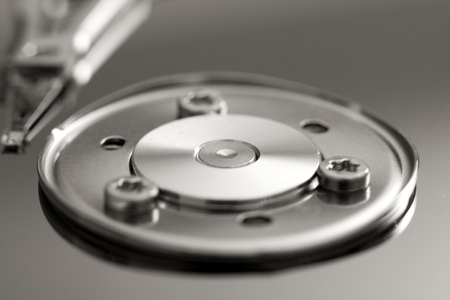 diskdrive: Picture with details from inside a computer hard drive. Stock Photo