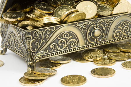 being the case: gold casket and gold coins on a white background