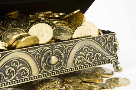 treasure box: gold casket and gold coins on a white background
