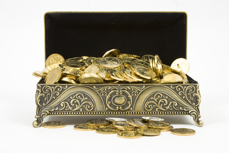personal ornaments: gold casket and gold coins on a white background
