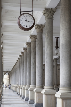 pavilon: Old clock, and stone columns in Karlovy Vary, Czech Republic