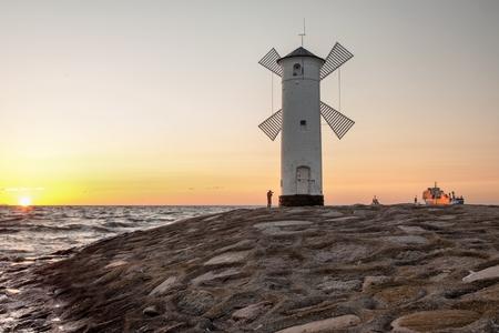 Lighthouse windmill Stawa Mills, Swinoujscie, Baltic Sea, Poland.
