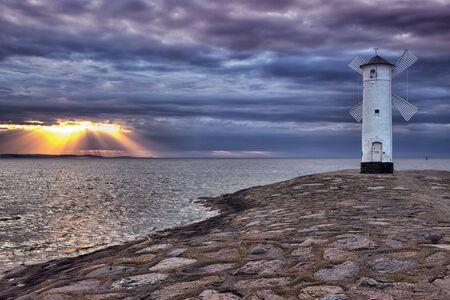 bristle: Lighthouse windmill Stawa Mills, Swinoujscie, Baltic Sea, Poland.