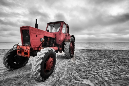 old tractor: old tractor on the beach