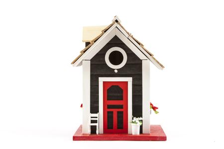 dollhouse: miniature house on a white background